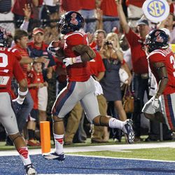 Mississippi tailback Randall Mackey (1) scores between teammates Donte Moncrief (12) and Jeff Scott (3) on a 3-yard touchdown against Texas in the second quarter of an NCAA college football game in Oxford, Miss., Saturday, Sept. 15, 2012.