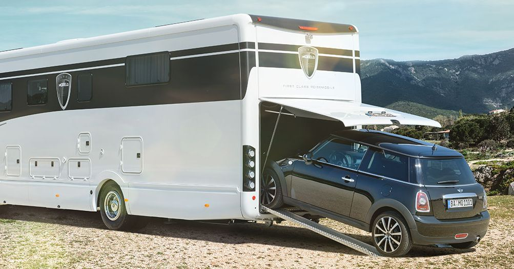 Luxury Rv Can Carry A Smart Car Inside Its Garage Curbed