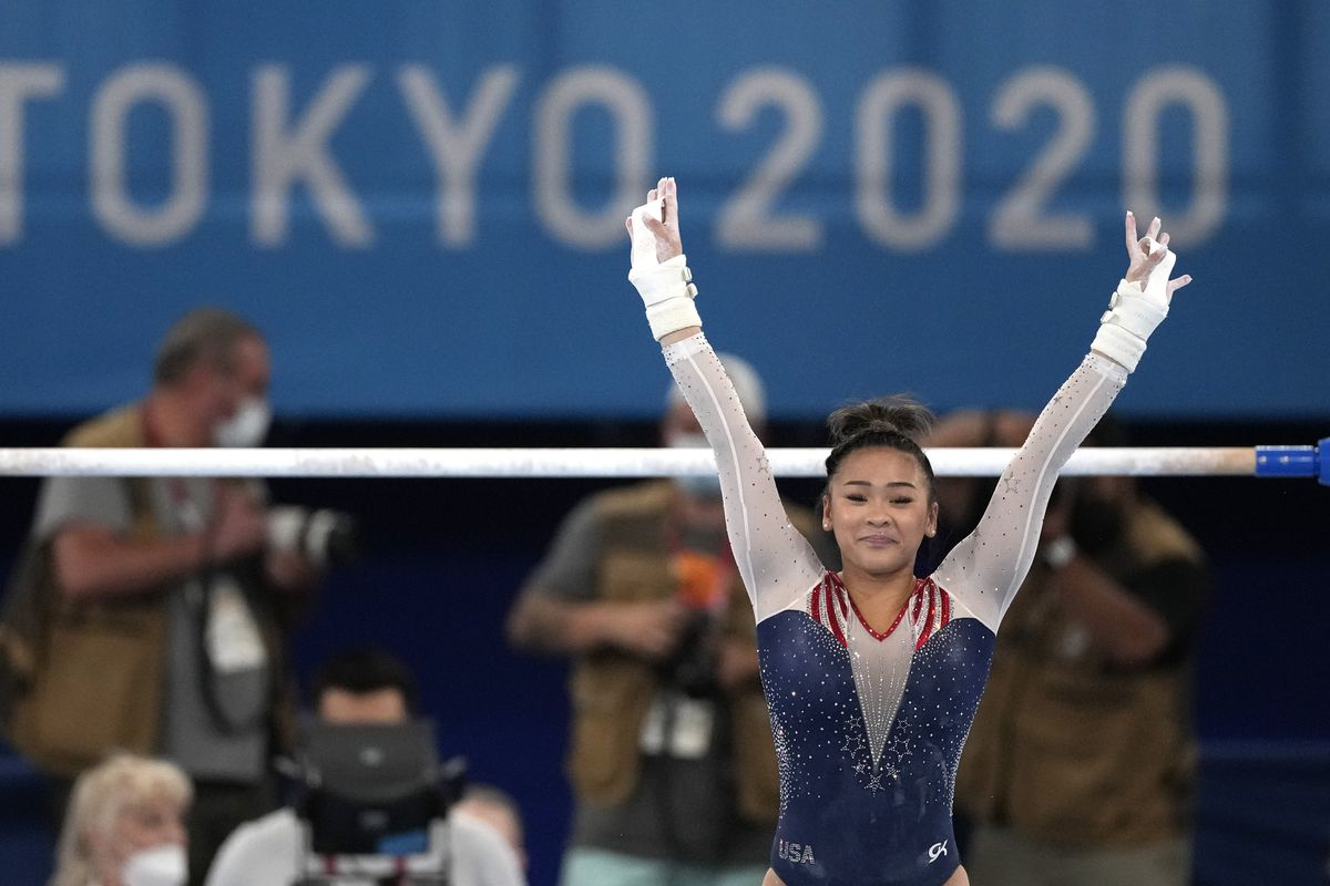 Sunisa Lee, of the United States, finishes on the uneven bars during the artistic gymnastics women's all-around final at the 2020 Summer Olympics on Thursday in Tokyo.