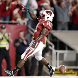 Wisconsin's Kenzel Doe reacts after scoring a touchdown on an 82-yard punt return during the second half of an NCAA college football game against Utah State on Saturday, Sept. 15, 2012, in Madison, Wis. Wisconsin won 16-14. (AP Photo/Morry Gash)