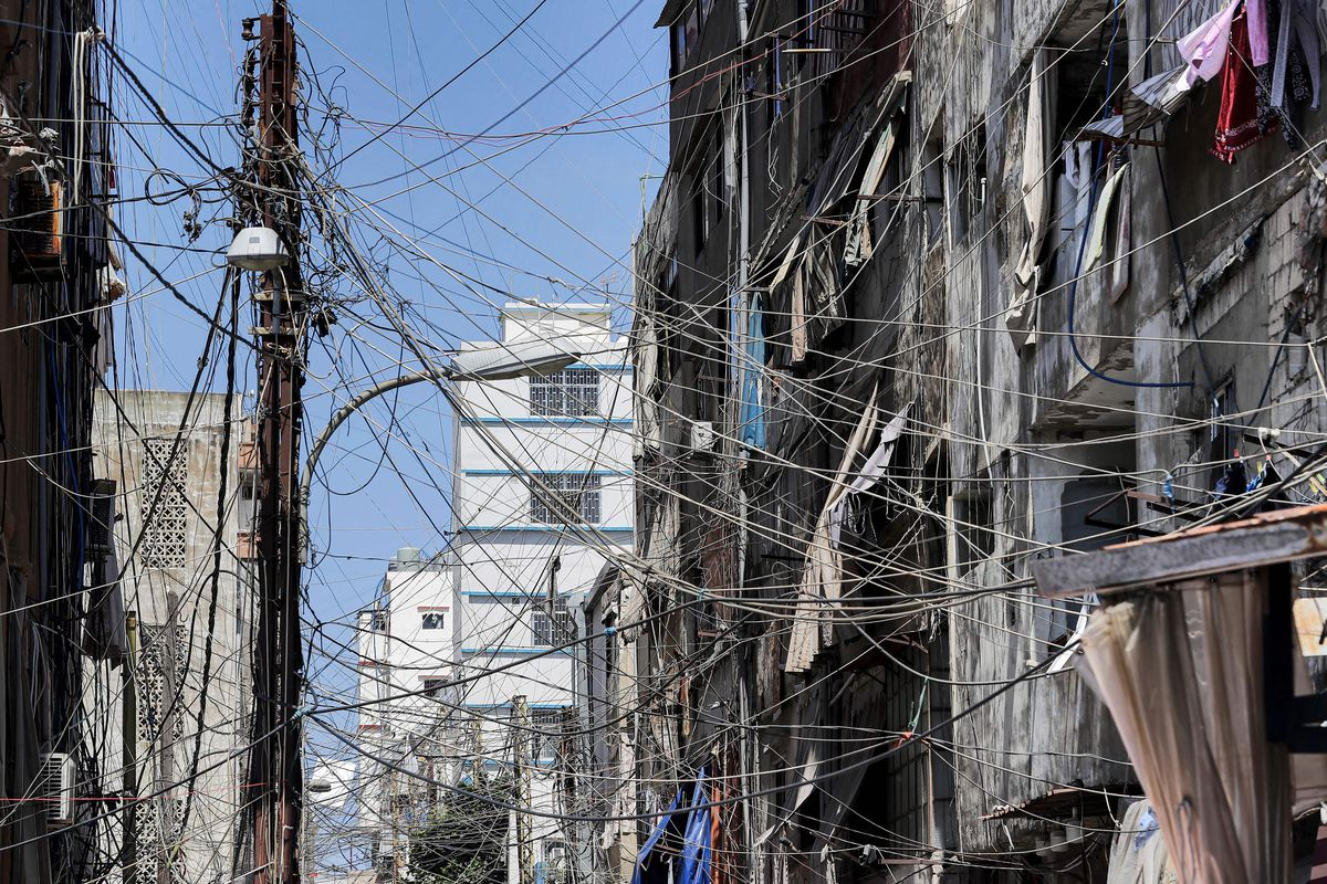 Power lines in a suburb of Beirut, Lebanon, run from a pole to nearby buildings.