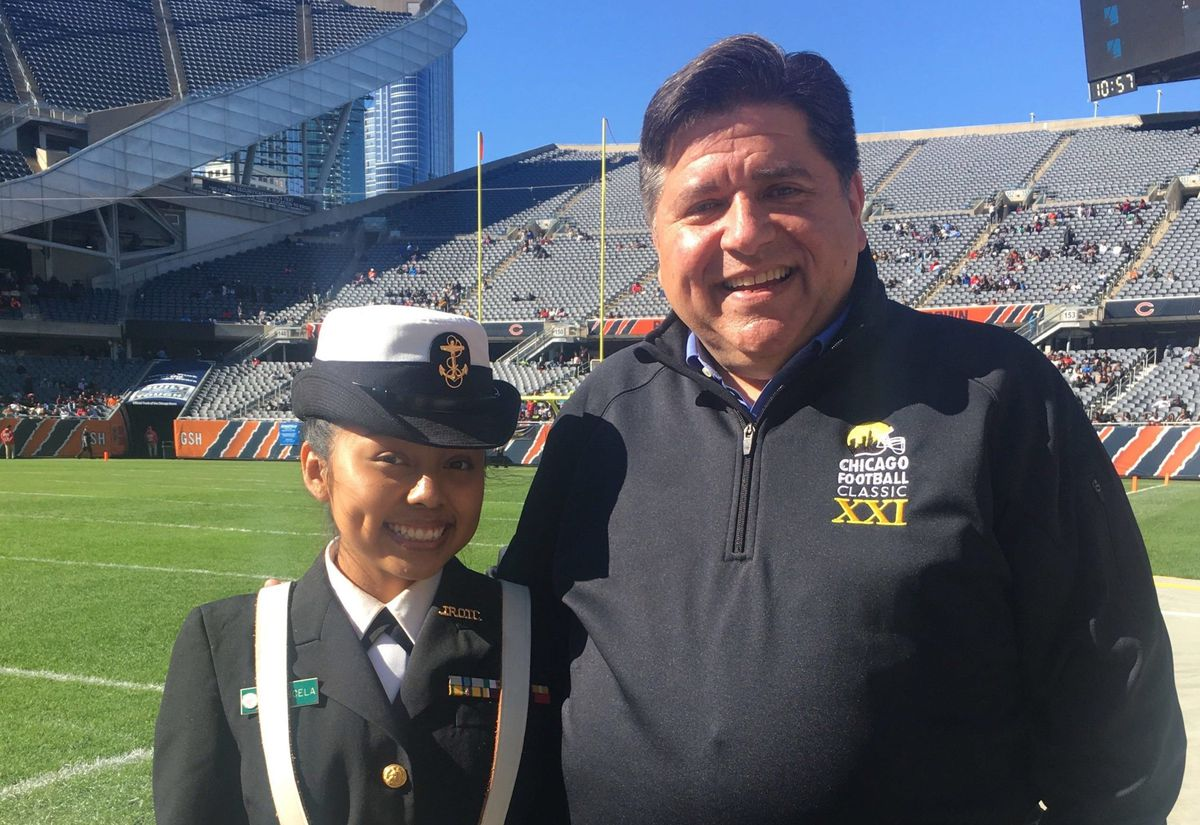 Chicago junior Luz Mayancela posed in 2019 with J.B. Pritzker, now Illinois governor, at Chicago's Soldier Field, where she took part in an ROTC color guard.