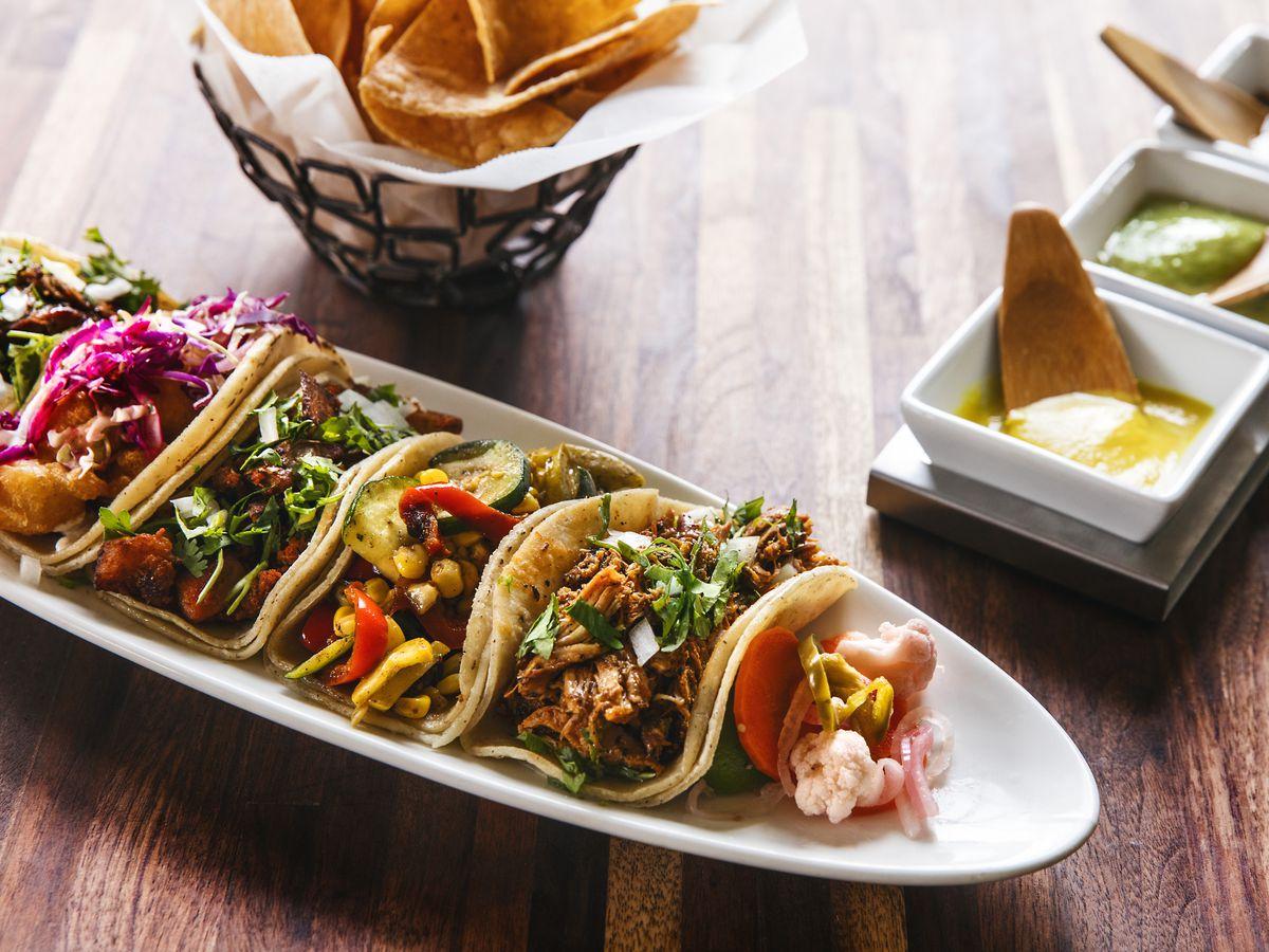 A variety of tacos, salsas, and tortilla chips from the San Francisco restaurant Tacolicious.