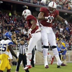 Stanford wide receiver Drew Terrell, center, celebrares his 11-yard touchdown catch with teammate Levine Toilolo (11) during the first half of an NCAA college football game in Stanford, Calif., Friday, Aug.  31, 2012.