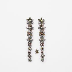 """We'd like these playful floral drops as much with black tie as we would with a white T-shirt and jeans. And again, the """"bonus stud"""" is back — good thing you defied mom in 9th grade with that second piercing."""