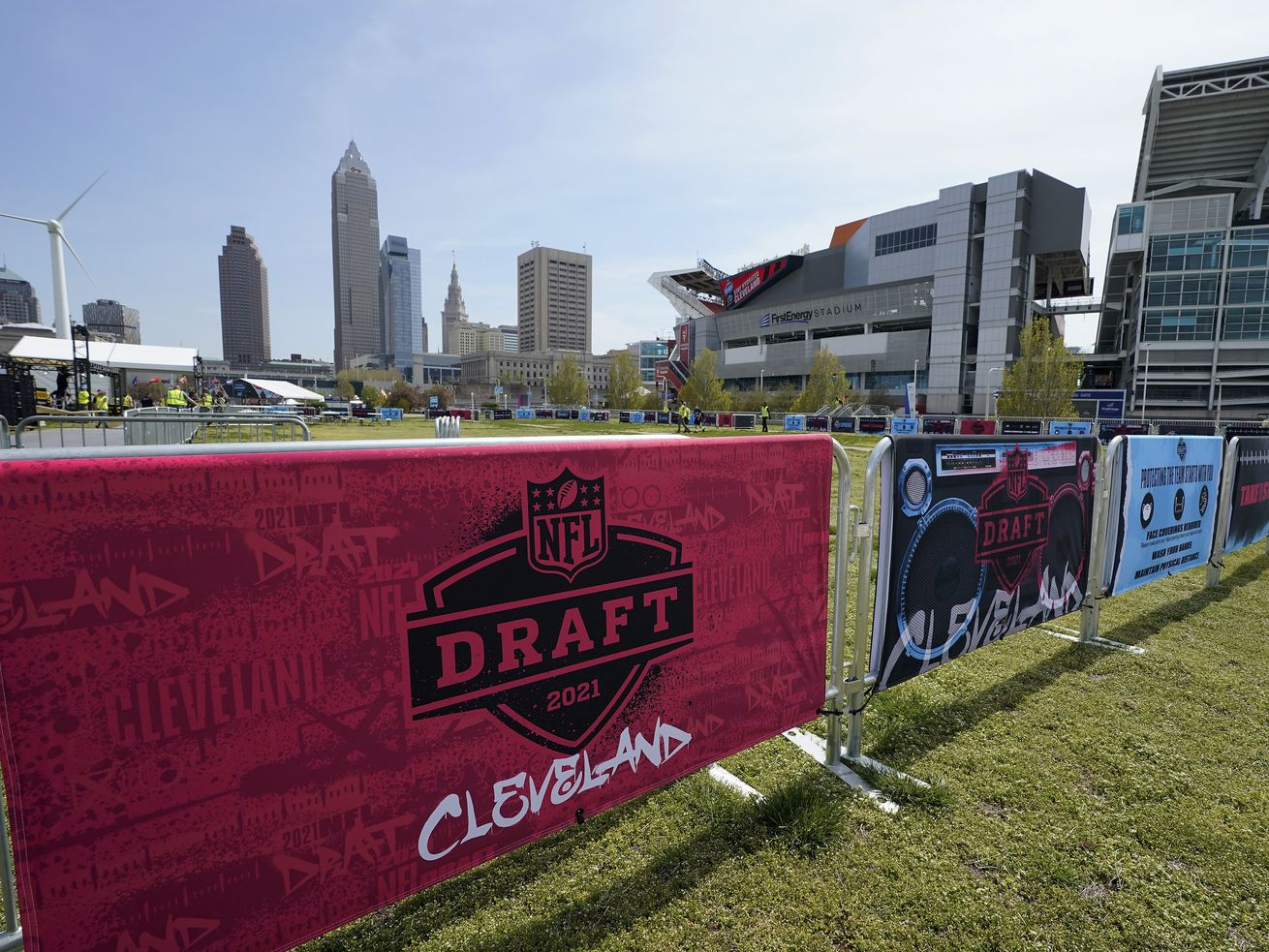 NFL Draft signs decorate the fan experience area near First Energy Stadium in Cleveland.
