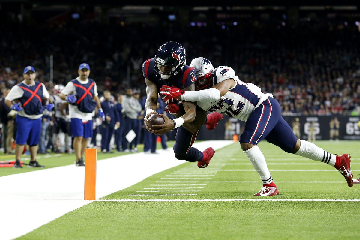 Deshaun Watson of the Houston Texans scores a touchdown against Elandon Roberts of the New England Patriots during the fourth quarter in the game at NRG Stadium on December 01, 2019 in Houston, Texas.