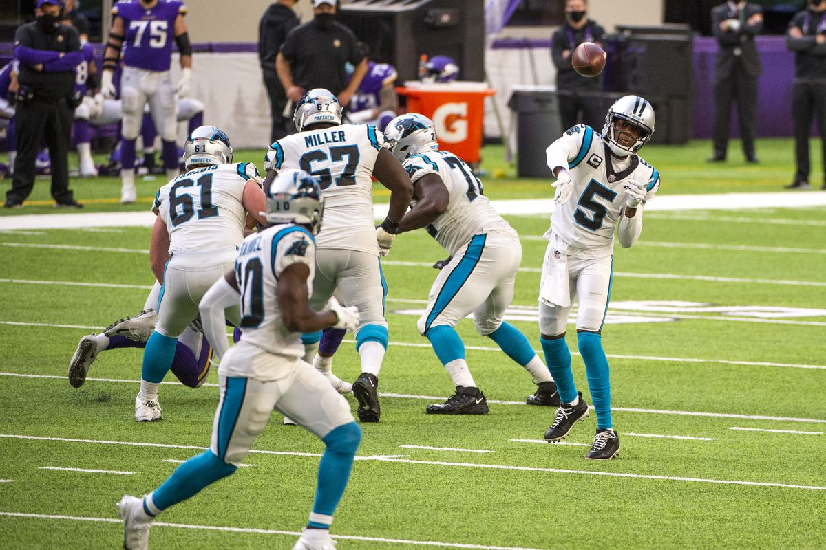 Teddy Bridgewater #5 passes the ball to Curtis Samuel #10 of the Carolina Panthers in the fourth quarter of the game against the Minnesota Vikings at U.S. Bank Stadium on November 29, 2020 in Minneapolis, Minnesota.