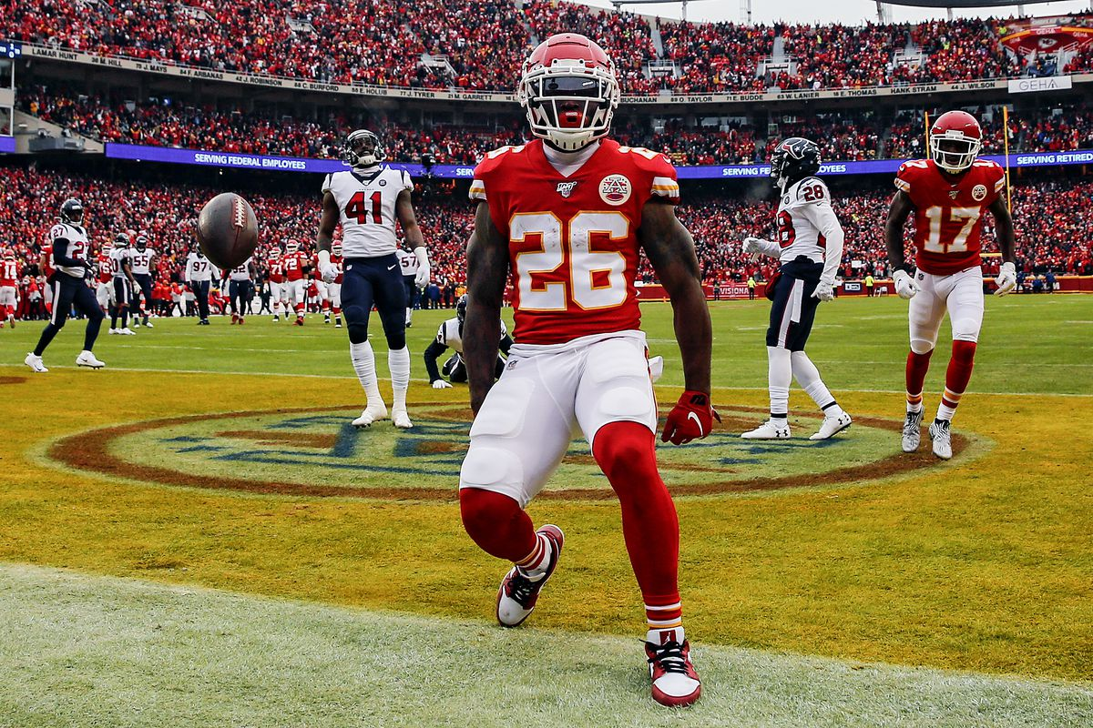 Damien Williams #26 of the Kansas City Chiefs celebrates his 17-yard touchdown reception against the Houston Texans during the second quarter in the AFC Divisional playoff game at Arrowhead Stadium on January 12, 2020 in Kansas City, Missouri.