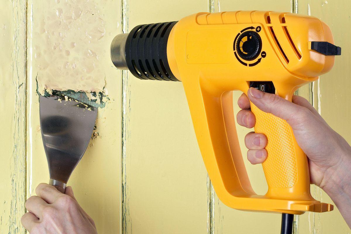 Using heat gun and scraper to help melt paint.