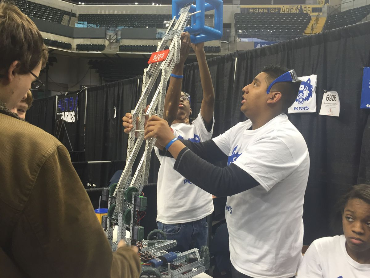 Freshman Jose Garcia and Sophomore Armon Badgett double-check their robot Sunday at the VEX robotics competition at Bankers Life Fieldhouse.