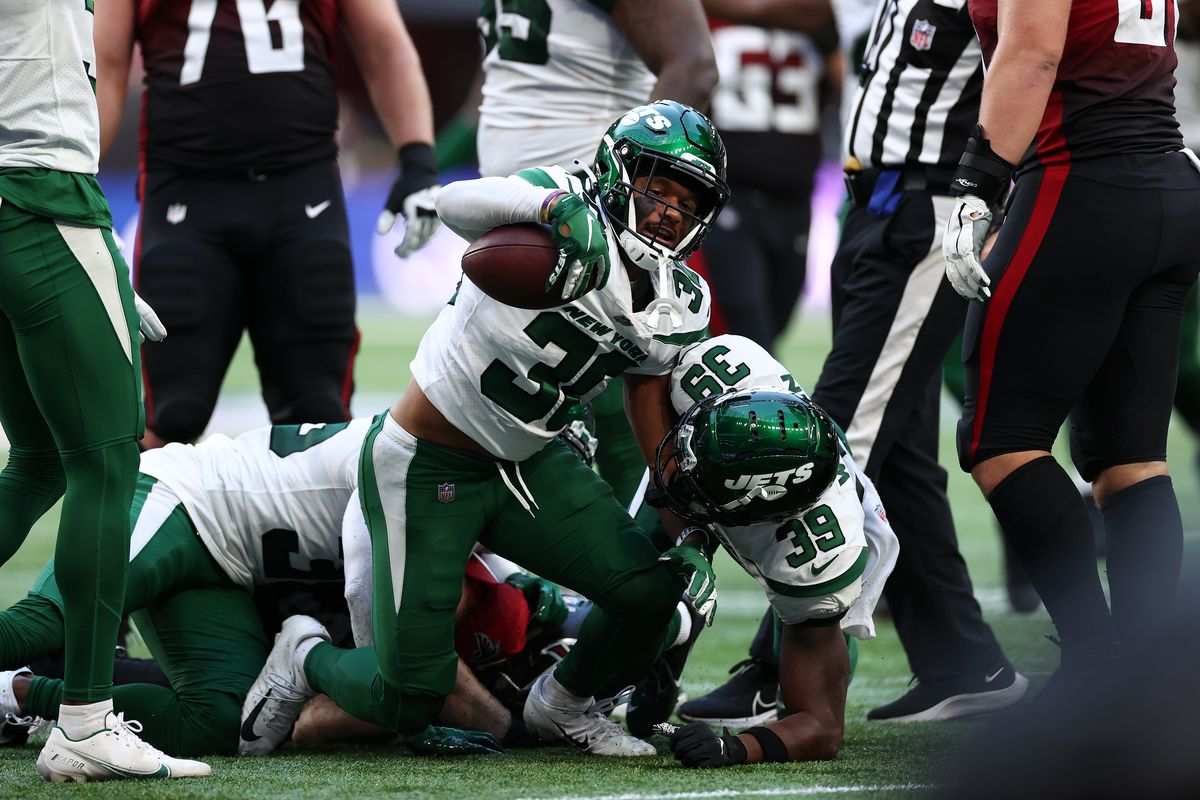 Michael Carter II #30 of the New York Jets celebrates a turnover during the NFL London 2021 match between New York Jets and Atlanta Falcons at Tottenham Hotspur Stadium on October 10, 2021 in London, England.