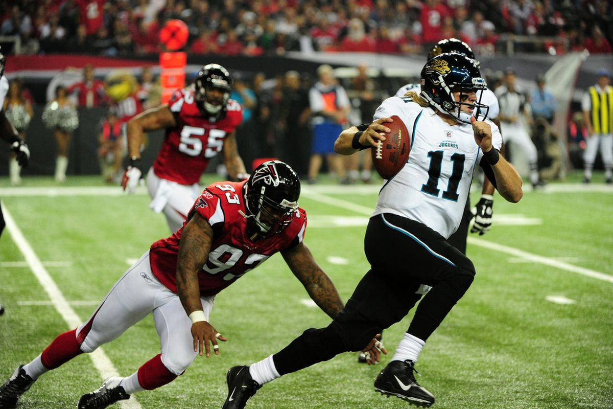 ATLANTA, GA - DECEMBER 15: Blaine Gabbert #11 of the Jacksonville Jaguars is pursued by Ray Edwards #93 of the Atlanta Falcons at the Georgia Dome on December 15, 2011 in Atlanta, Georgia. (Photo by Scott Cunningham/Getty Images)