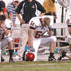 Utah players, left to right, Thomas Huff, Pete Aneiro, Taylor Miller, John Madsen and Chad Jacobsen watch helplessly as TCU scores in overtime.