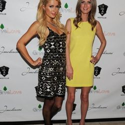 Paris Hilton and Nicky Hilton arrive at the grand opening of 1 OAK.