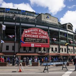 Fans wait to enter Wrigley Field before the Chicago Cubs Opening Day game against the Pittsburgh Pirates.