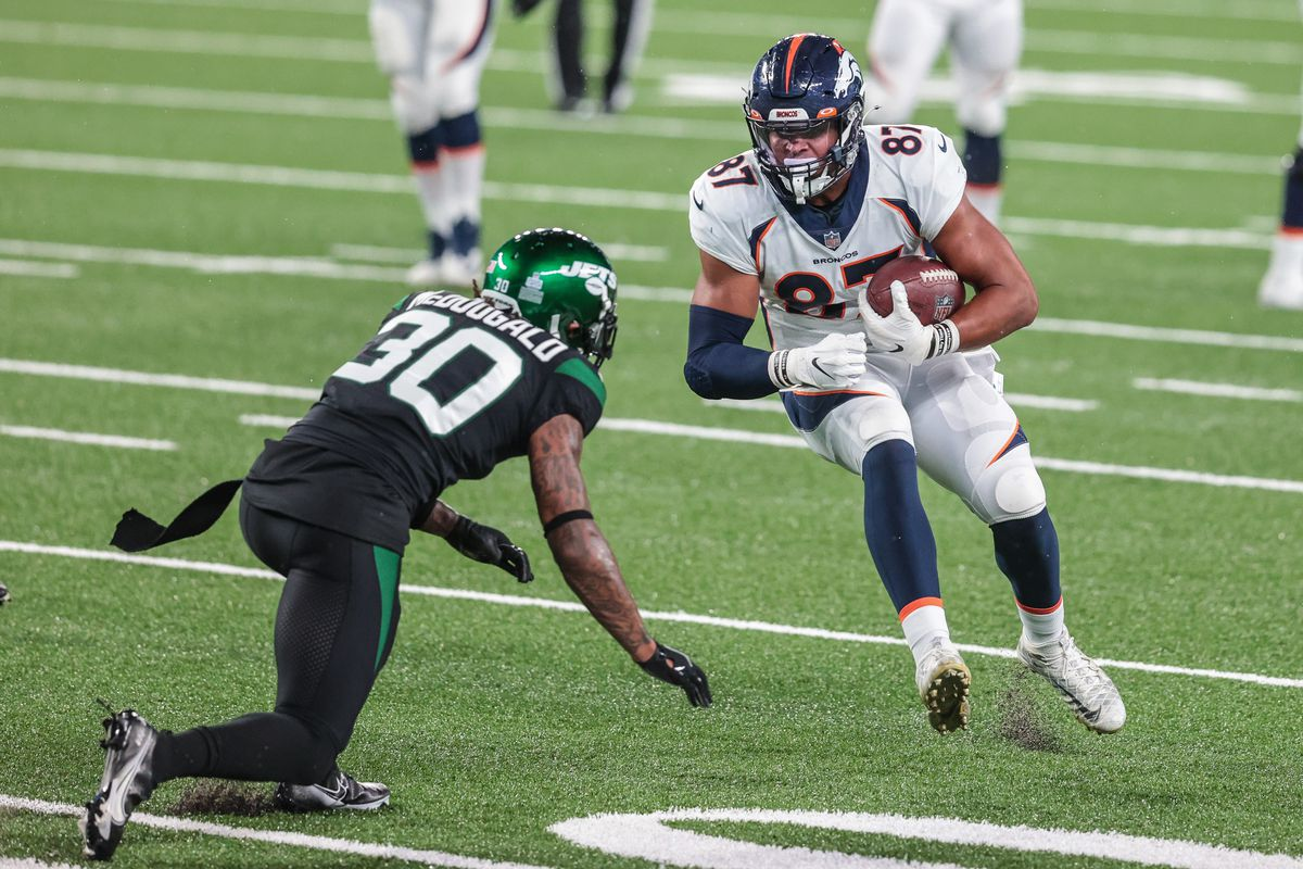 Denver Broncos tight end Noah Fant (87) gains yards after catch as New York Jets strong safety Bradley McDougald (30) defends during the second half at MetLife Stadium.