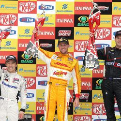 IndyCar driver Will Power of Australia, right, Ryan Hunter-Reay of the U.S., center and Takuma Sato, of Japan, celebrate their first, second and third place wins at the IndyCar's Sao Paulo 300 in Sao Paulo, Brazil, Sunday, April 29, 2012.