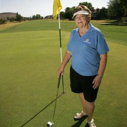 """FILE - Former governor Olene Walker poses on the green at the golf course near her Saint George, UT home. """"I used to say when I'd play golf three times a week, I'd be ready for the pro circuit,"""" said Walker, adding that while she has enjoyed becoming a frequent golfer, she's """"not a pro"""" yet."""