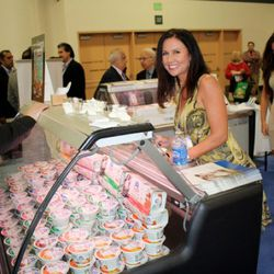 This booth was stocked with women in exceedingly tight dresses American market newcomer Olympus Greek yogurt.<br />