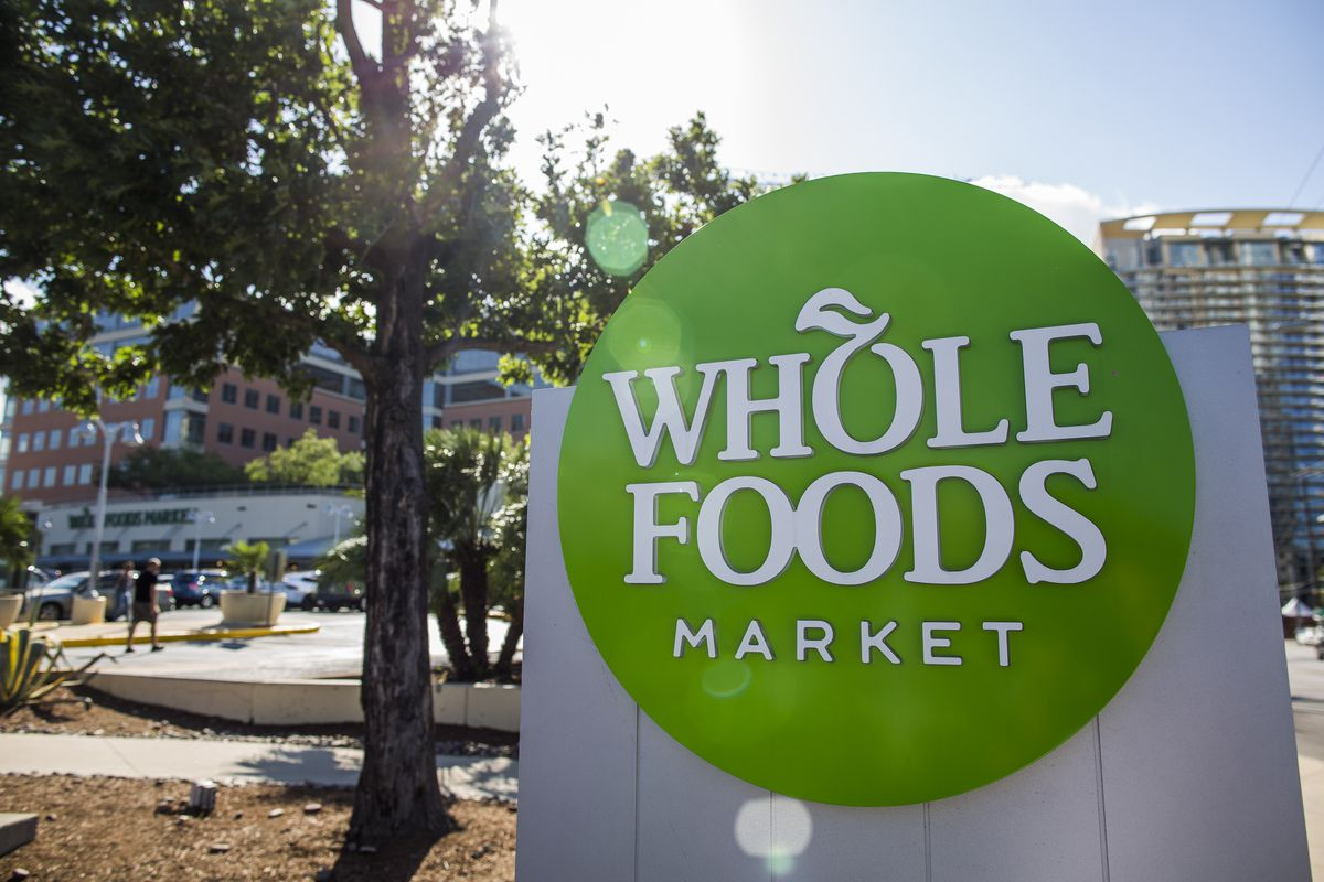 Whole Foods Market sign outside its flagship store in Austin, Texas