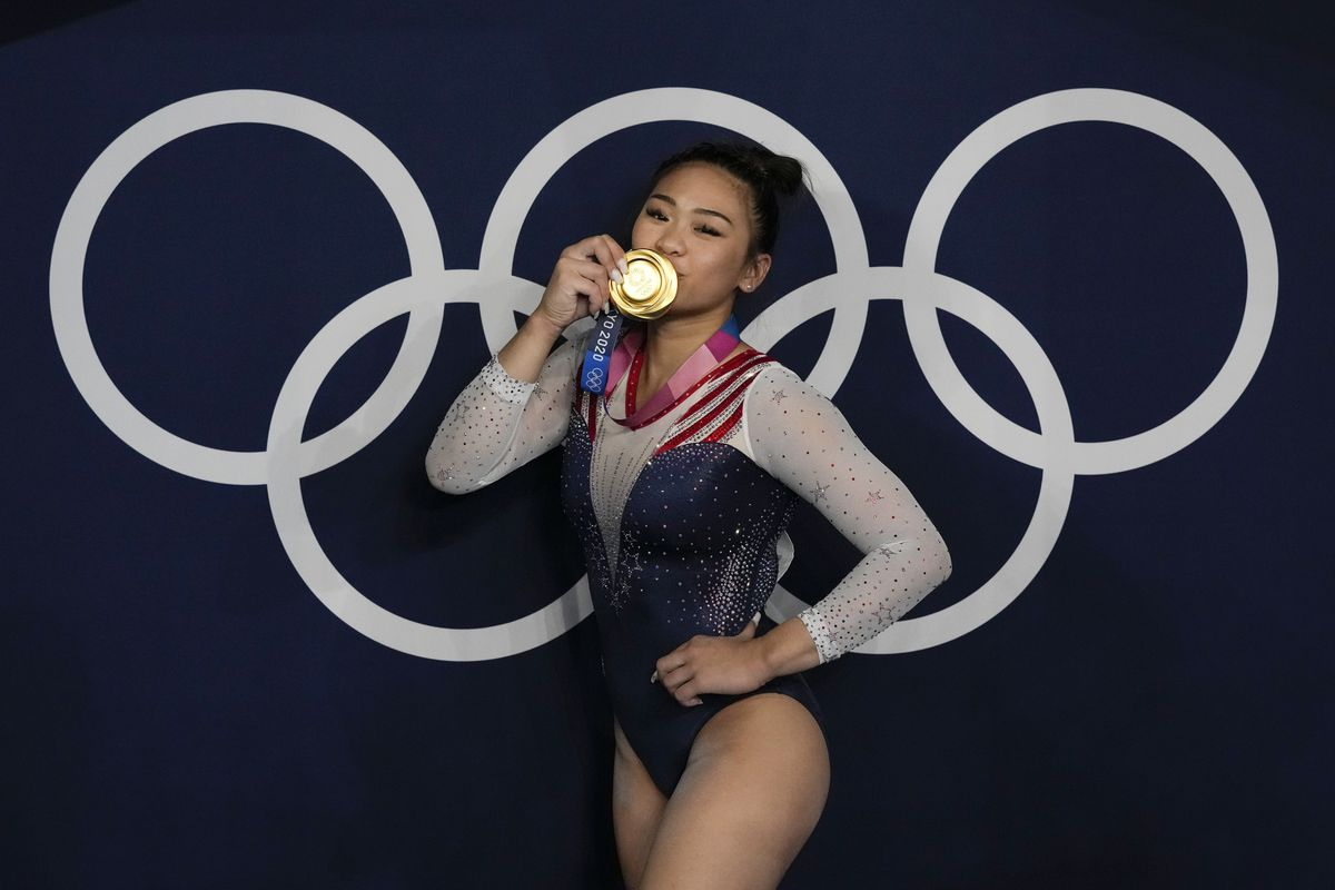 Sunisa Lee poses with her Olympic gold medal.