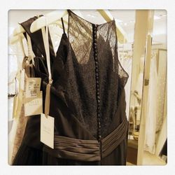 The back of a black gown from the collection.