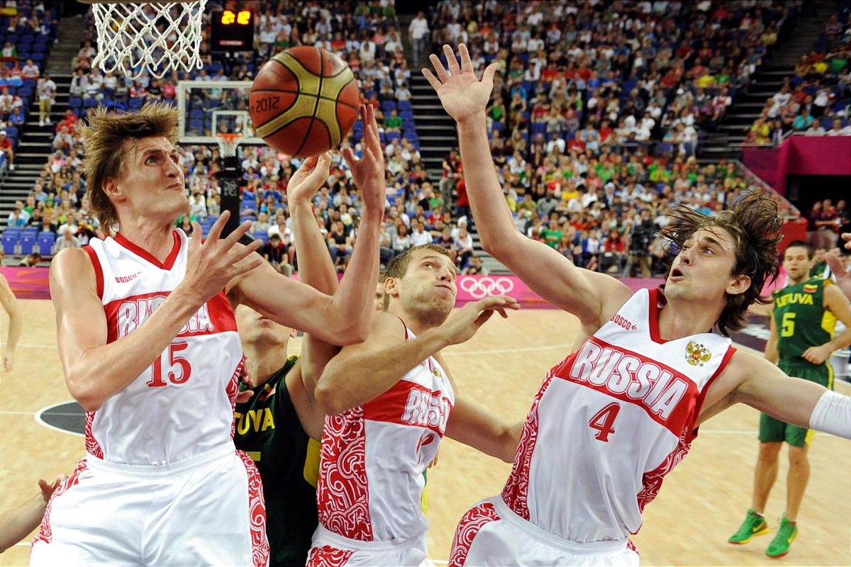 FILE - This Aug. 8, 2012 file photo shows Russian forwards Andrei Kirilenko, left, Sergey Monya, center, and guard Alexey Shved, right, during a men's quarterfinal basketball game at the 2012 Summer Olympics in London. Kirilenko and Shved have enjoyed the