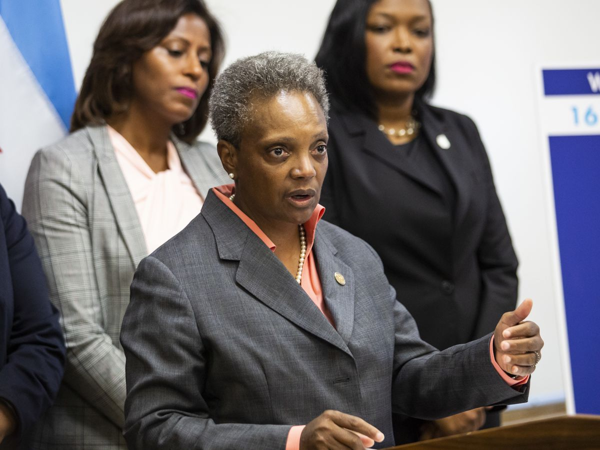Chicago Public Schools Chief Education Officer LaTanya McDade and CEO Janice Jackson (right) and Mayor Lori Lightfoot
