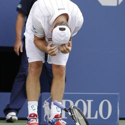 Andy Roddick drops his racket during his match against Argentina's Juan Martin Del Potro in the quarterfinals during the 2012 US Open tennis tournament,  Wednesday, Sept. 5, 2012, in New York. (AP Photo/Darron Cummings)