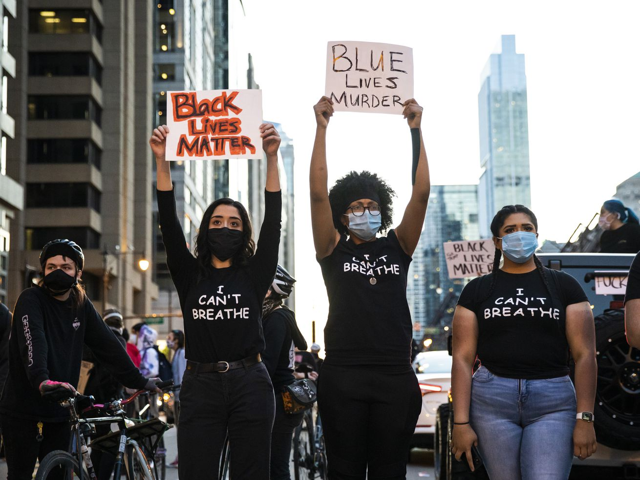 Protesters hold placards Saturday, May 30 in Chicago as they join national outrage over the death of George Floyd.