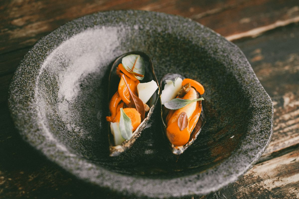 Stone bowl with two mussels at Malva restaurant