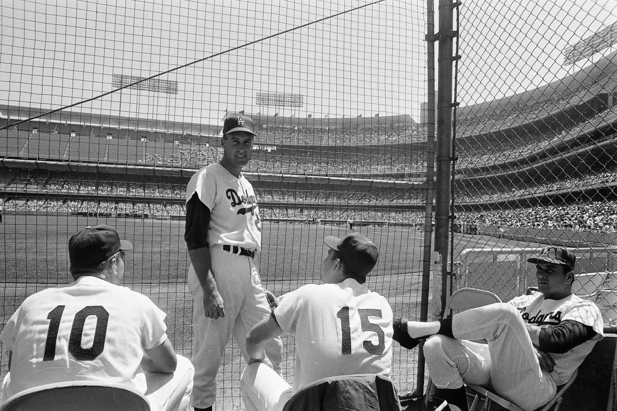 Phil Regan, standing in the Dodgers bullpen with (L to R), catcher Jeff Torborg and pitchers Bob Miller and Ron Perranoski in 1966.
