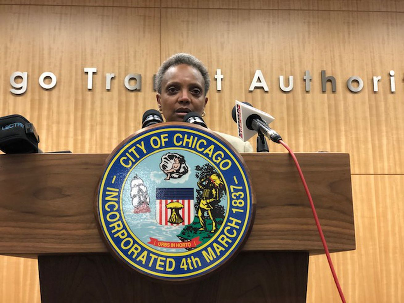 Mayor Lori Lightfoot answers questions from reporters at CTA headquarters after a celebratory news conference on the state's $45 billion capital plan.