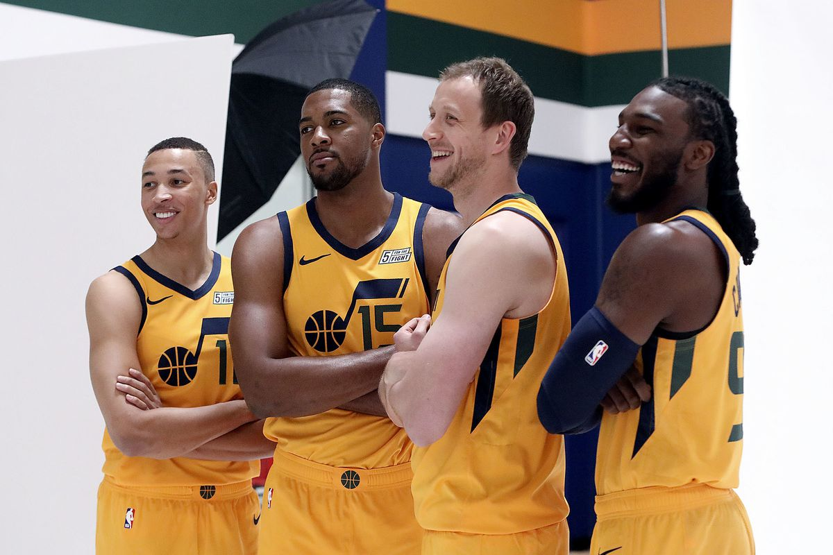 Dante Exum, Derrick Favors, Joe Ingles and Jae Crowder pose for a portrait during Jazz media day at the Zions Bank Basketball Center in Salt Lake City on Monday, Sept. 24, 2018.