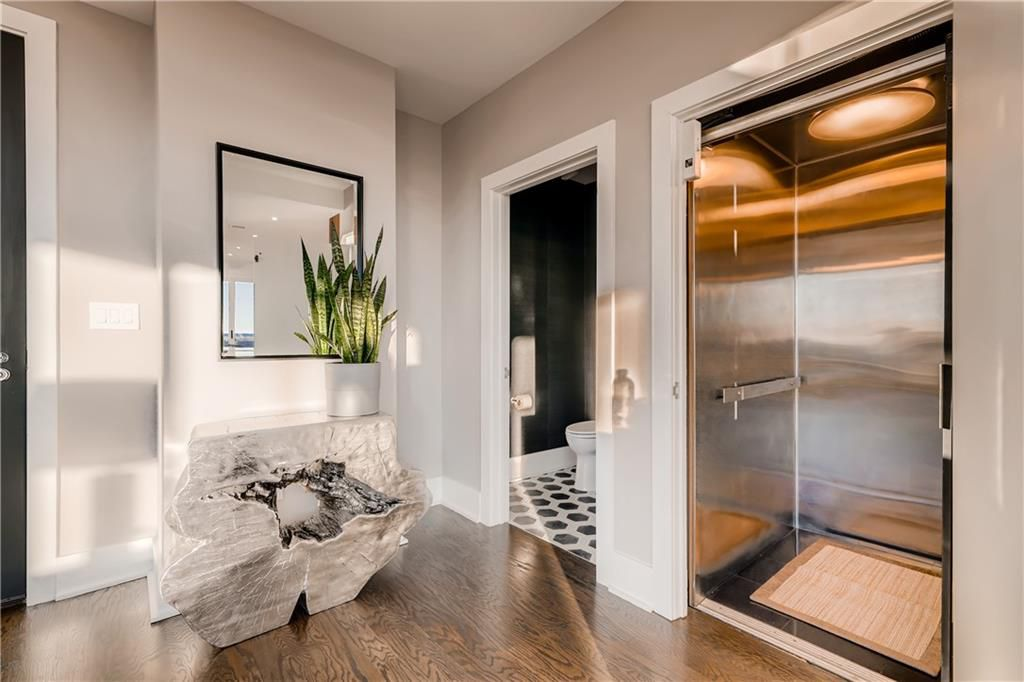 A private elevator with a bathroom beyond it.
