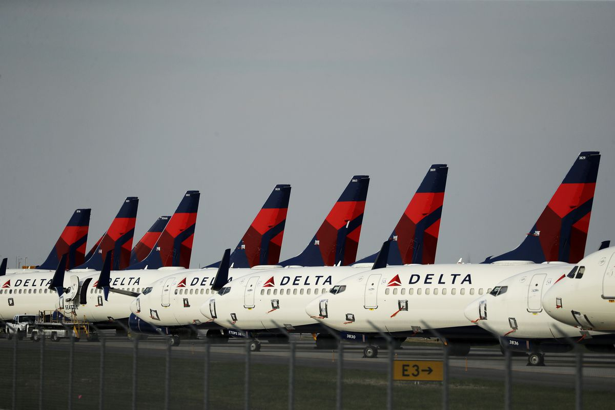 Several dozen mothballed Delta Air Lines jets are parked at Kansas City International Airport in Kansas City, Mo., on April 1, 2020.