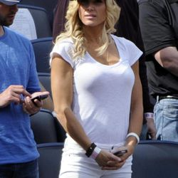 Retired wrestler Torrie Wilson watches the New York Yankees and Los Angeles Angels play a baseball game Saturday, April 14, 2012 at Yankee Stadium in New York.