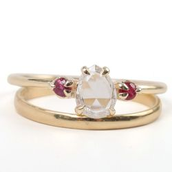 """<a href=""""https://catbirdnyc.com/shop/product.php?productid=19587&cat=491&page=1"""">Leda the Swan with rubies (top)</a>,  $3,200; <a href=""""https://catbirdnyc.com/shop/product.php?productid=19246&cat=491&page=1"""">Half-round band</a>, $270"""