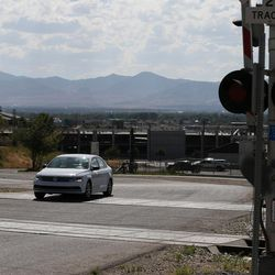 A car drives trough a railroad crossing on 9th Avenue in Midvale on Tuesday, Aug. 9, 2016.