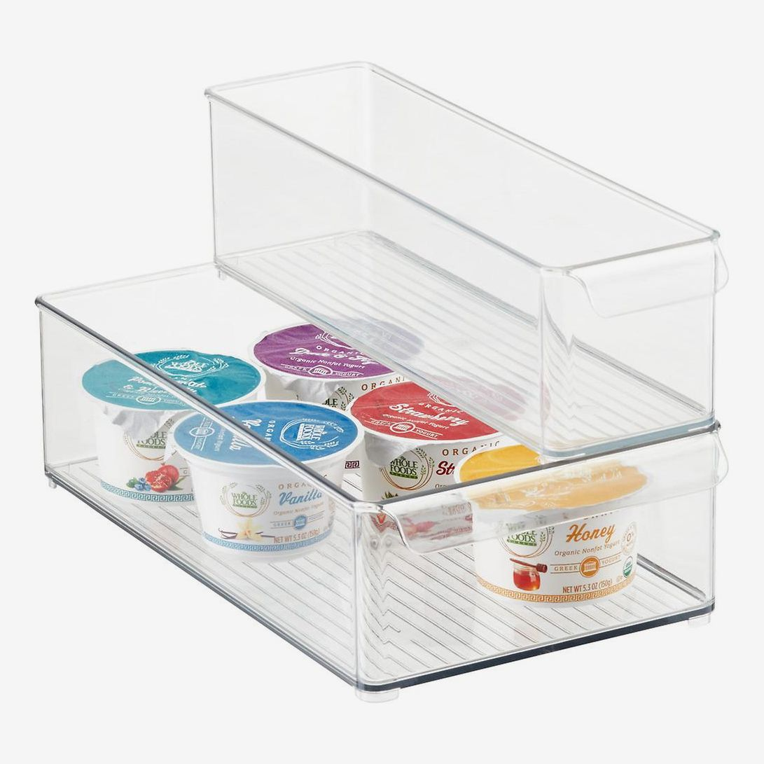 A clear storage bin containing five single serve yogurt containers