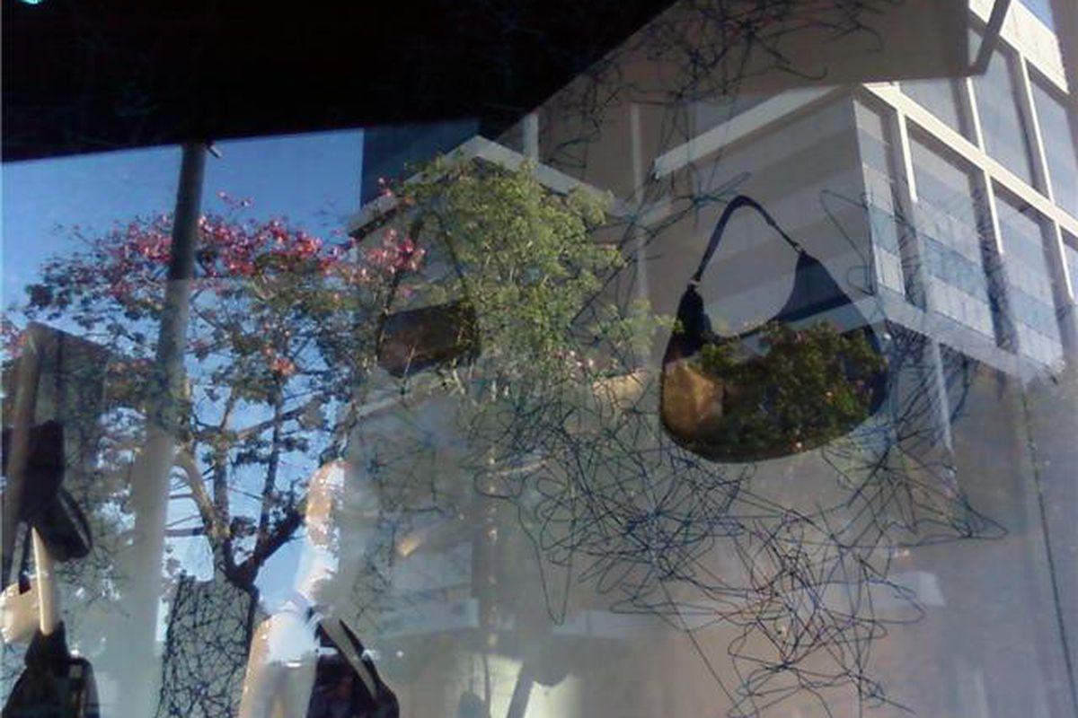 Handbags dangle from a hanger tree at Barneys, Beverly Hills