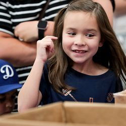 Makayla Ayala, 7, smiles while looking through boxes of free school supplies during Operation Homefront's annual Back-to-School Brigade event at Hill Field Elementary in Clearfield on Tuesday, Aug. 13, 2019.