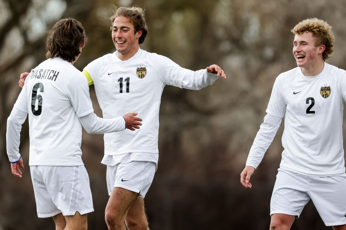 Wasatch's Isaac Jackson, Josh Jeppson and Jack Jarret celebrate after Jackson scored during a boys soccer game in Springville on Tuesday, March 23, 2021.