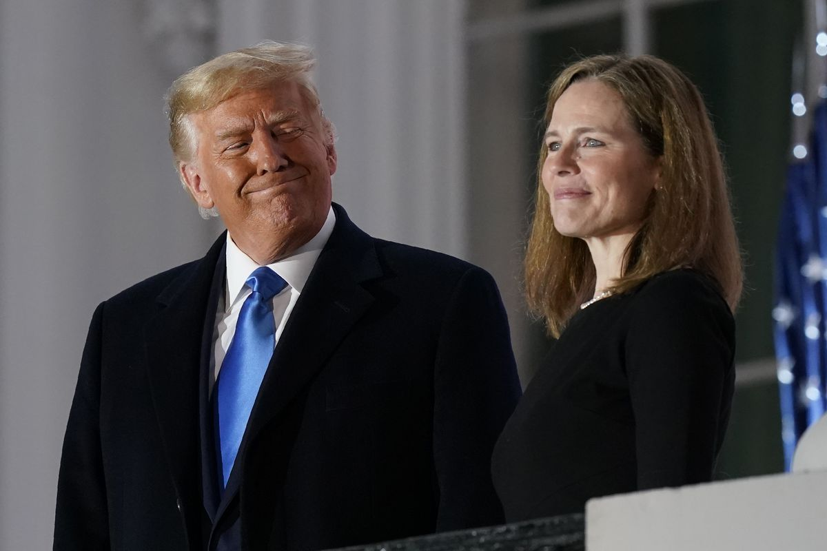 President Donald Trump and Amy Coney Barrett stand on the Blue Room Balcony after Supreme Court Justice Clarence Thomas administered the Constitutional Oath to her on the South Lawn of the White House last week.