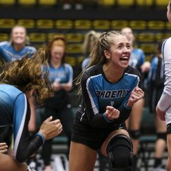 Farmington defensive specialist Ellie Darling (1) and her team celebrate a point during the 5A high school state finals match at the UCCU Center on the Utah Valley University campus in Orem on Saturday, Nov. 9, 2019.