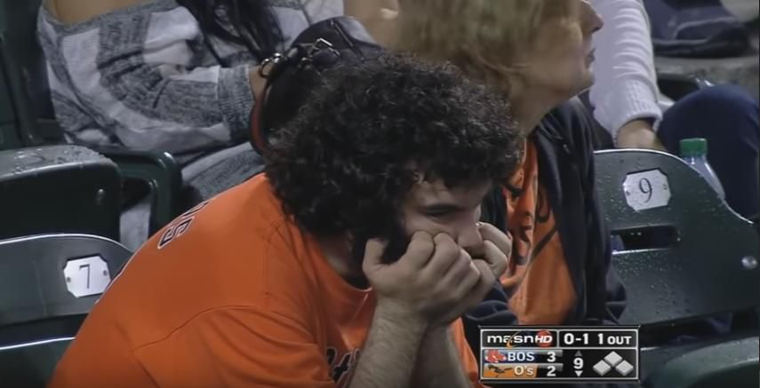 A nervous Orioles fan watches the team in the ninth inning of Game 162 in 2011.