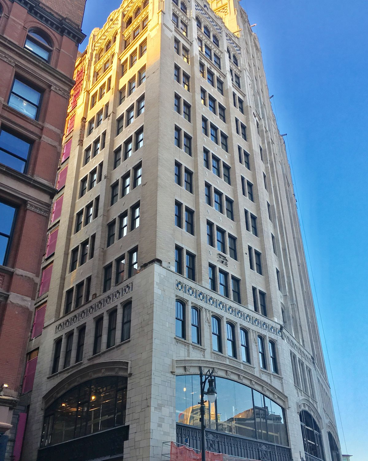 The exterior of the Metropolitan building in Detroit. The facade is tan brick with many windows.