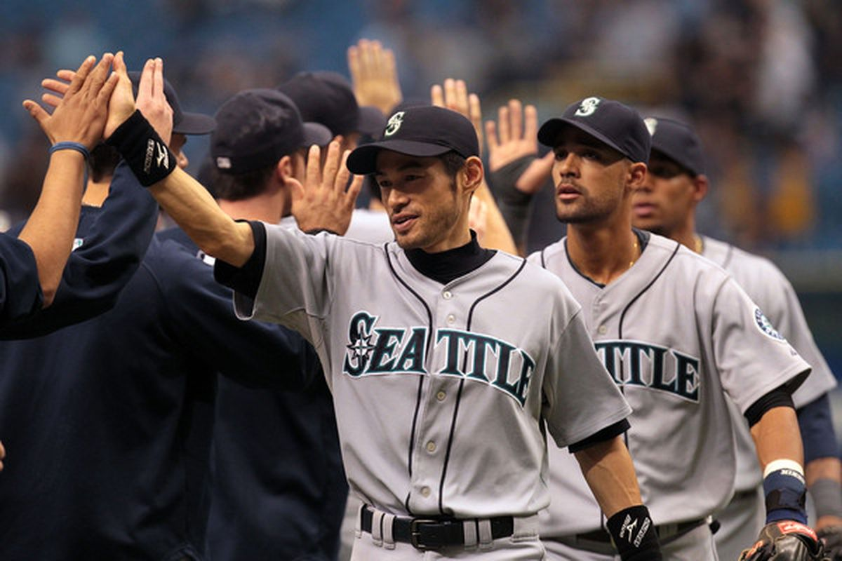 ST PETERSBURG FL - SEPTEMBER 26: Ichiro Suzuki #51 of the Seattle Mariners celebrates a 6-2 win with teammates against the Tampa Bay Rays at Tropicana Field on September 26 2010 in St. Petersburg Florida. (Photo by Eliot J. Schechter/Getty Images)