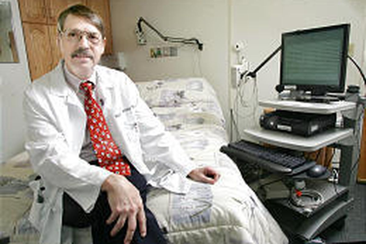 Dr. Robert Farney sits in a sleep-test room at LDS Hospital. He'll field hotline questions about sleeping problems Saturday.